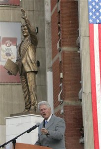 Former U.S. President Bill Clinton speaks in front of his statue in the capital Pristina
